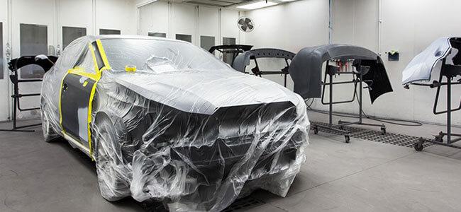 apple collision center paint booth black car shrink wrap