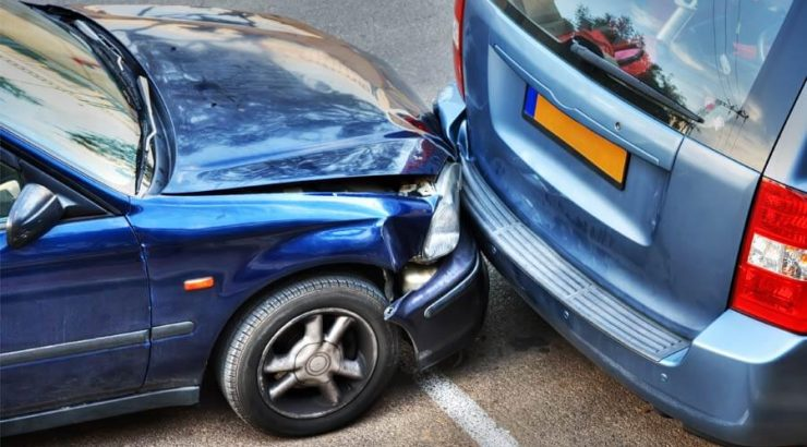 two blue cars crash accident damage