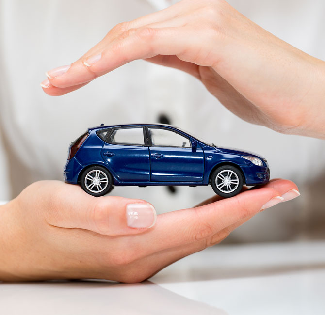 small toy blue car in two hands